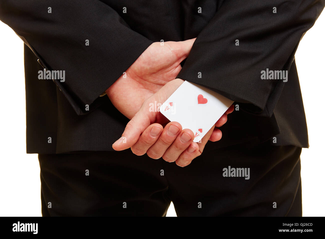 Businessman taken from the back with an ace under his sleeve - Stock Image