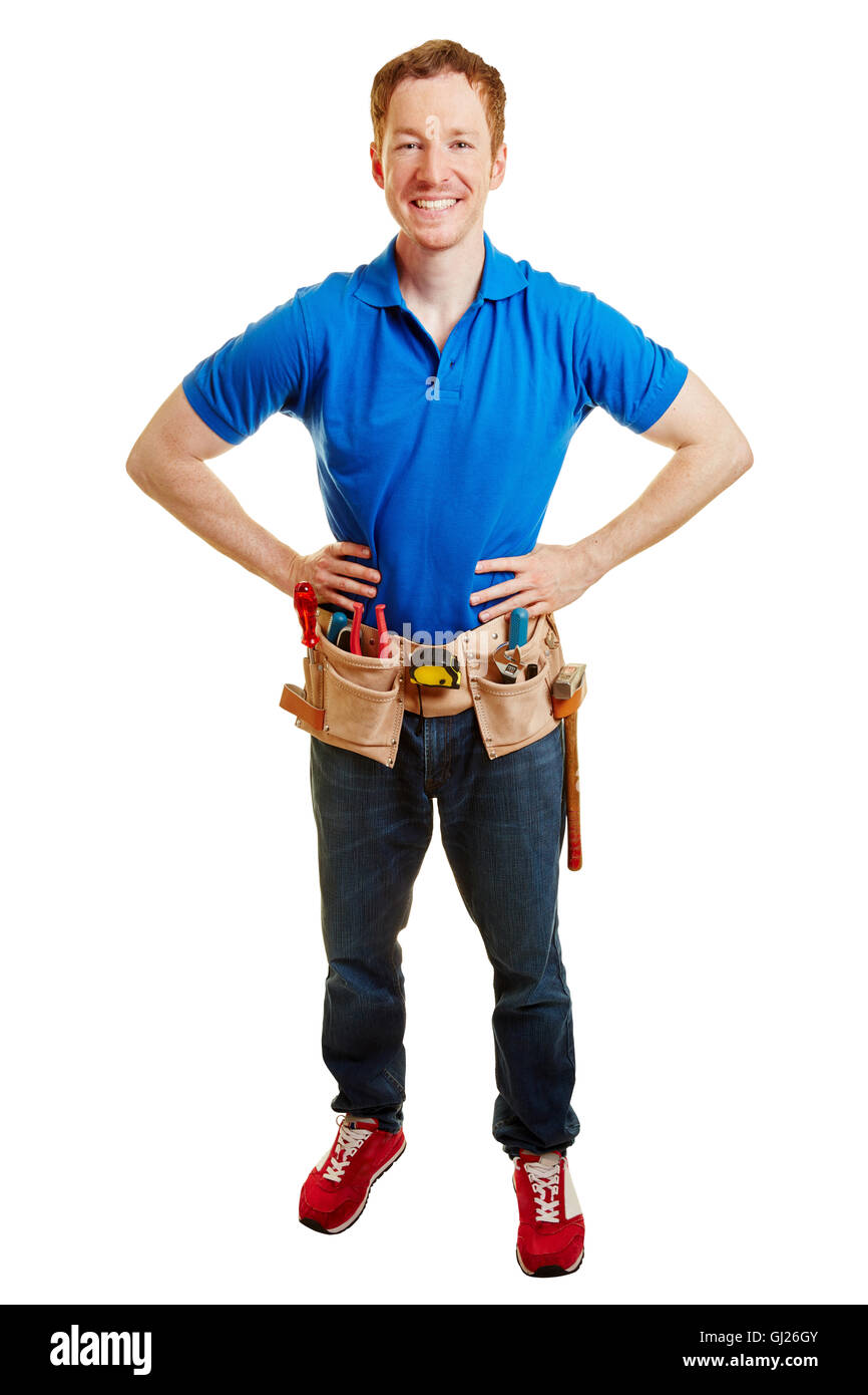 Man as an artisan smiling with his hands on the hips - Stock Image