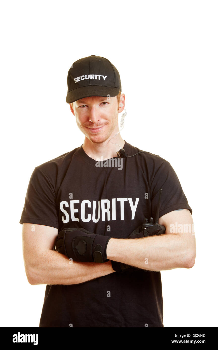 Man as a bouncer with security clothes and a radio - Stock Image