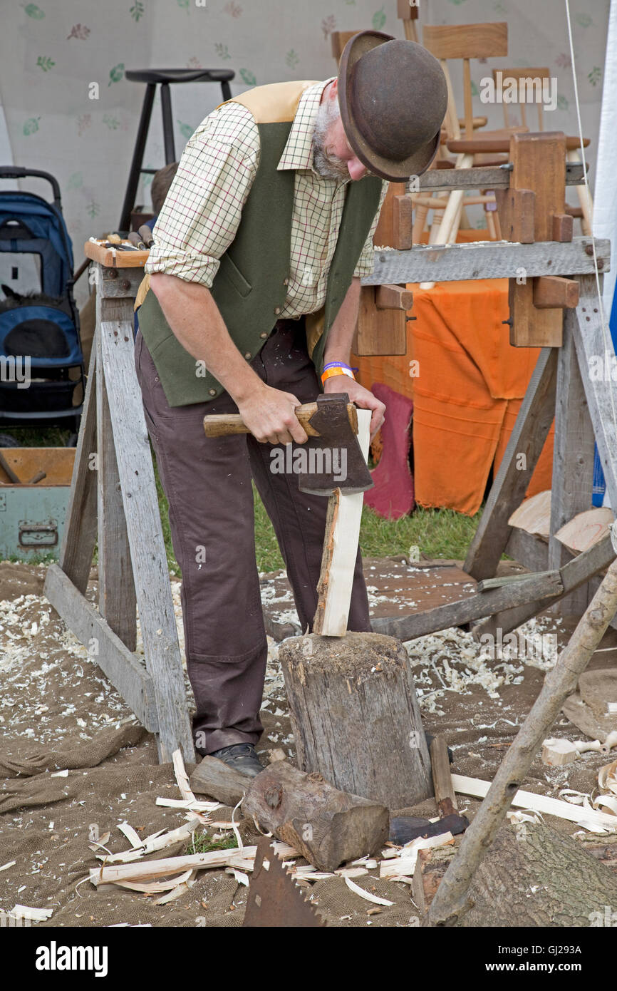Bodger trimming ash billet with axe prior to wood turning Countryfile Live 2016 Blenheim Palace Woodstock UK - Stock Image
