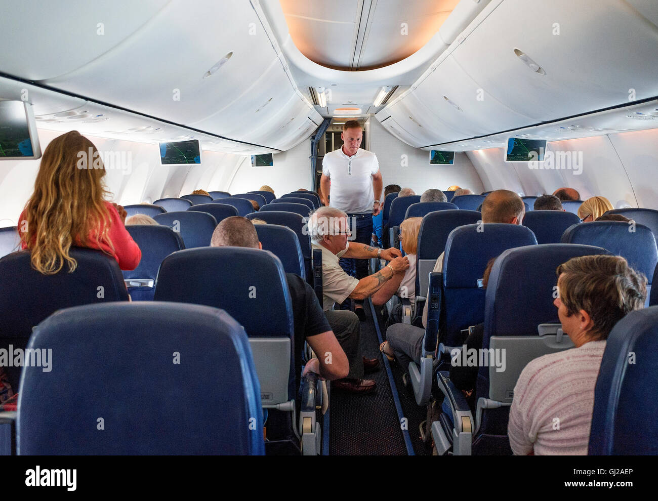 Inside the cabin of a Holiday charter flight airplane - Stock Image