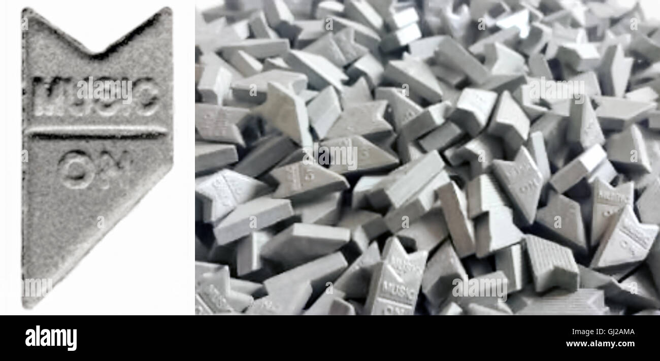 "Newly pressed ""Silver Music On"" Ecstasy pills containing around 200mg of MDMA (3,4-methylenedioxy-N-methylamphetamine), - Stock Image"