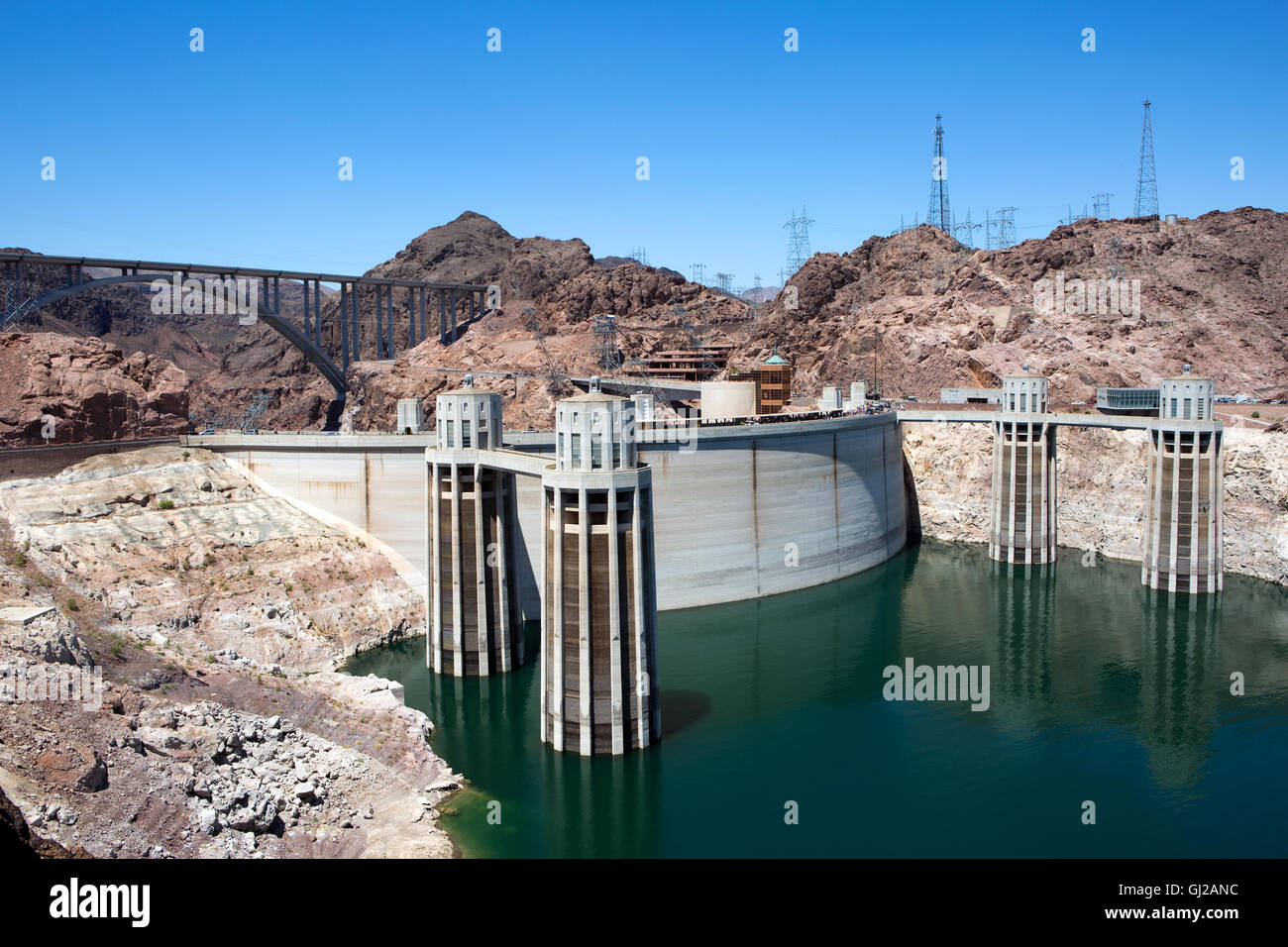 Hoover Dam located on the borders of Nevada and Arizona as it generates electricity from the flow of the Colorado - Stock Image