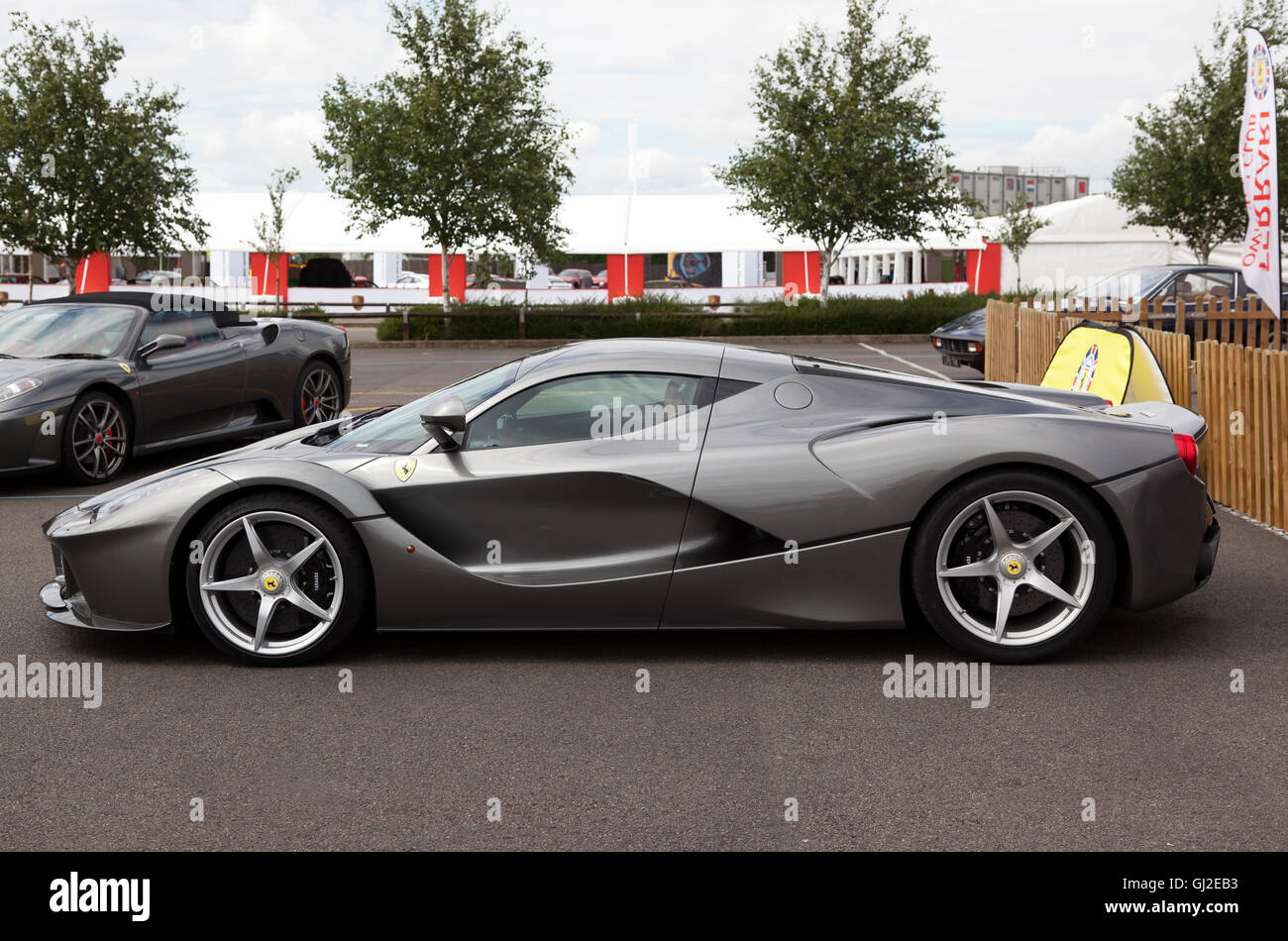 Side view of a LaFerrari, a hybrid sports car on display in the Ferrari Owners Club area of the Silverstone Classic - Stock Image