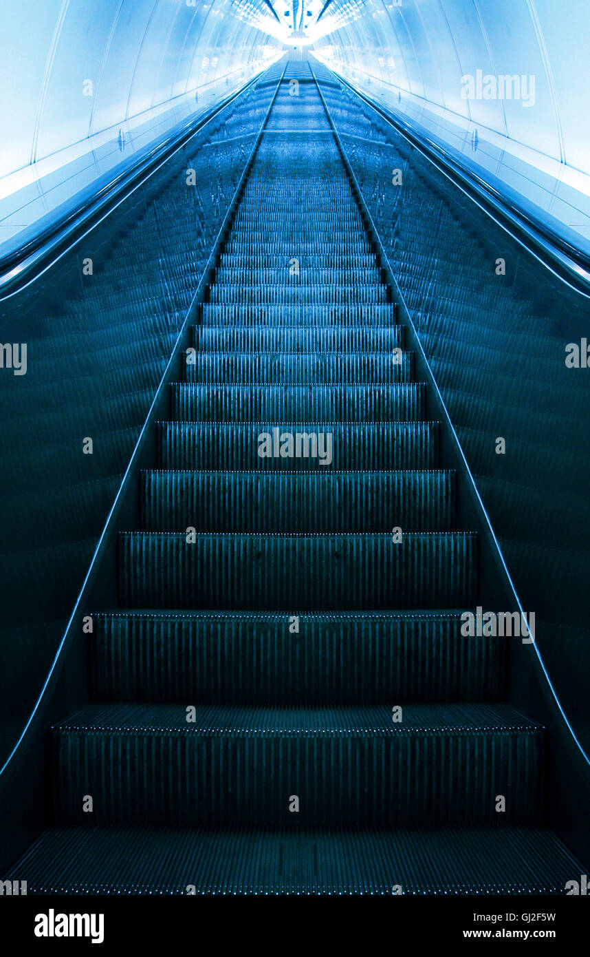 empty escalator going up - success metaphor - Stock Image