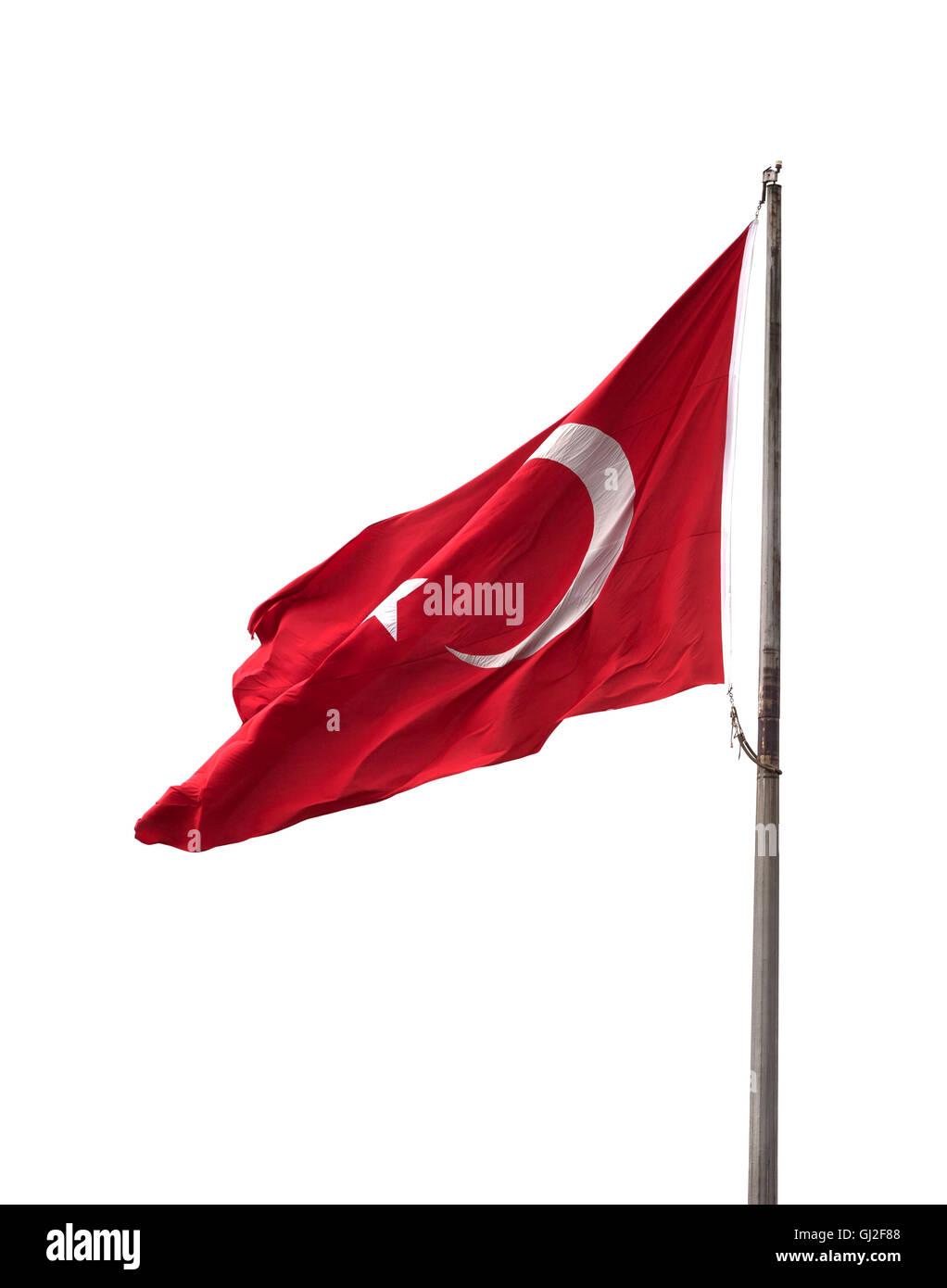 Turkish flag on flagpole waving in windy day. Isolated on white background. - Stock Image