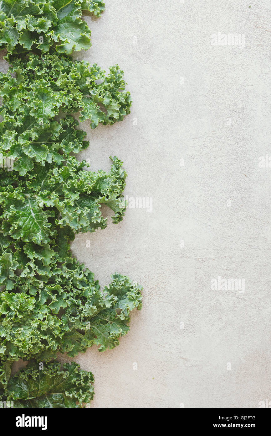 Border Of Fresh Green Leaves On Rustic Background Top View Blank Space