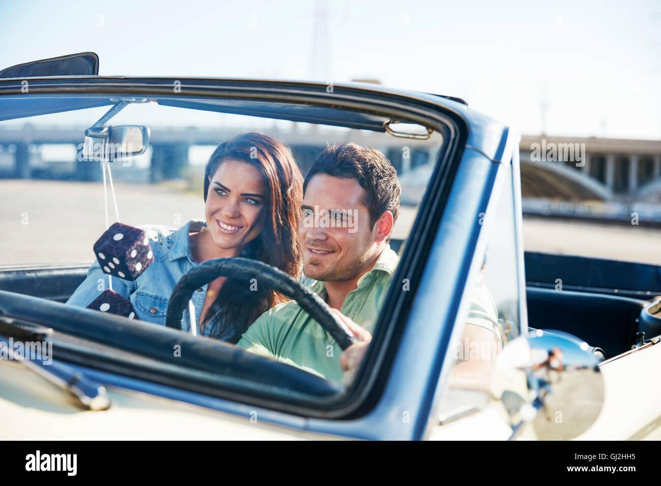 Couple in convertible car, Los Angeles, California, USA - Stock Image