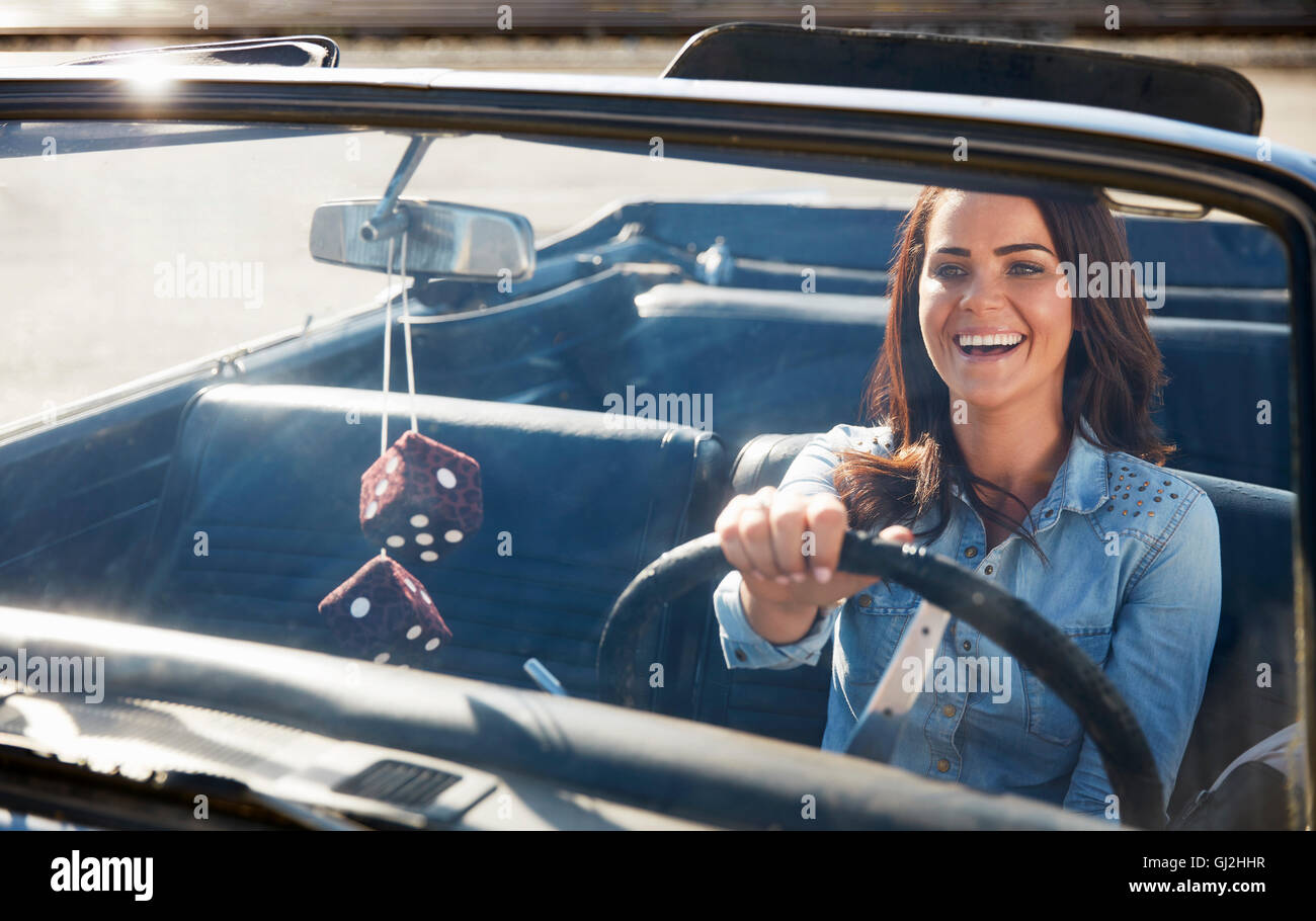 View through windscreen of woman driving convertible car, Los Angeles, California, USA - Stock Image