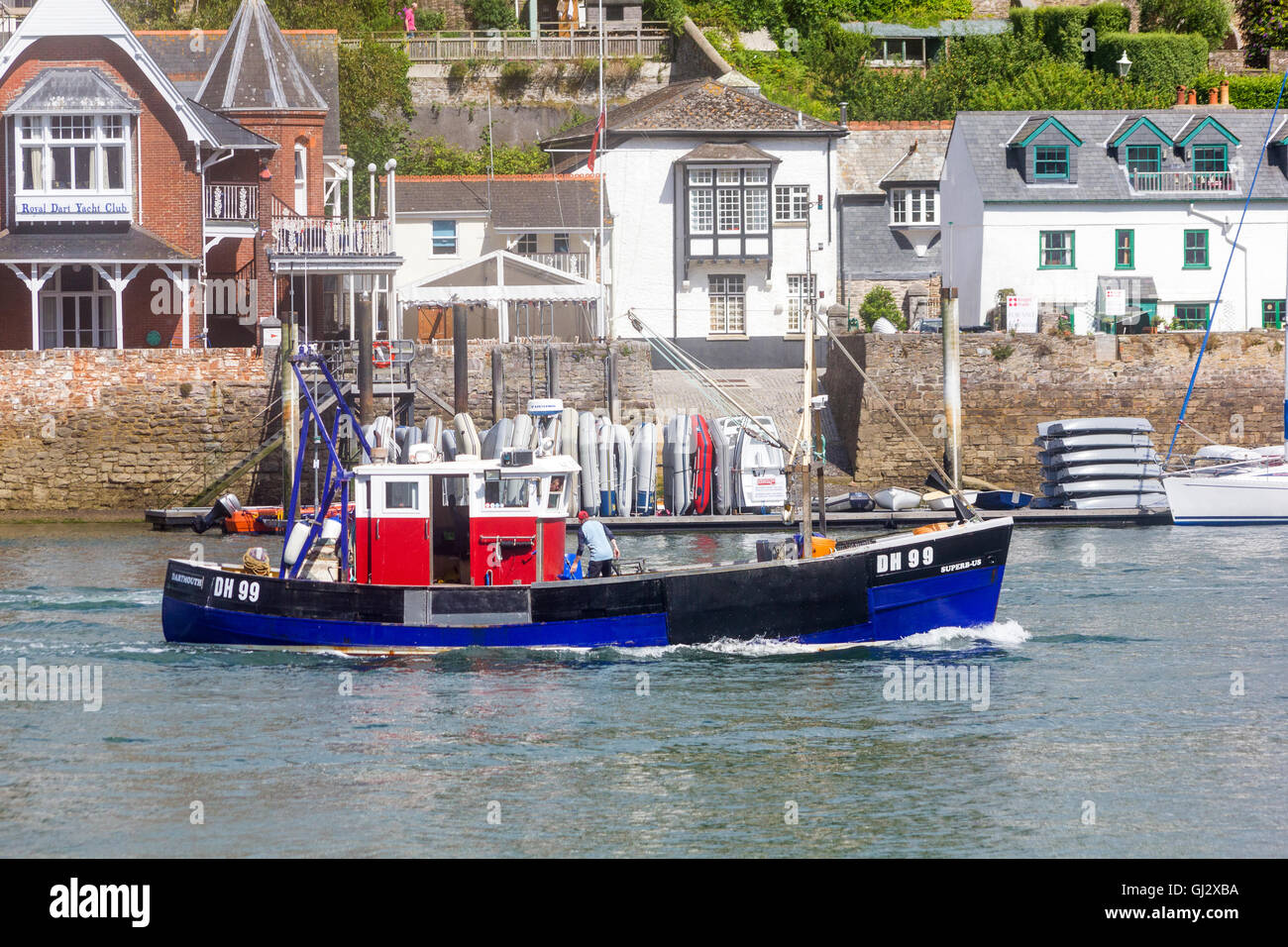 View from Castle Road, Dartmouth, Looking Across the River Dart to Kingswear as the Fishing Vessel 'Superb-Us' - Stock Image