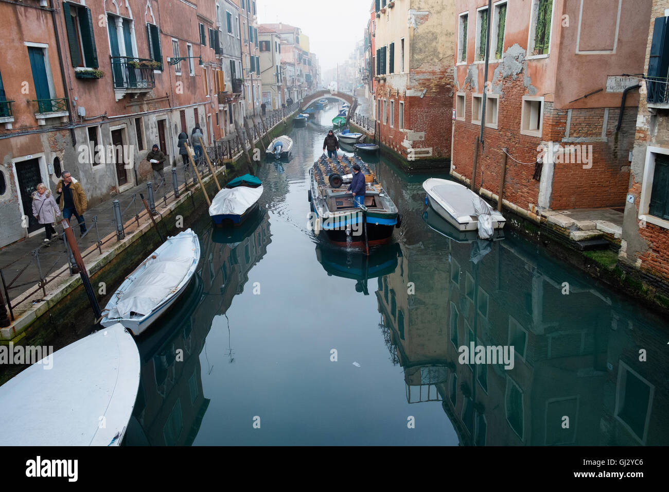 Cargo Barge On The Venice Canal Delivering Wine To The Local