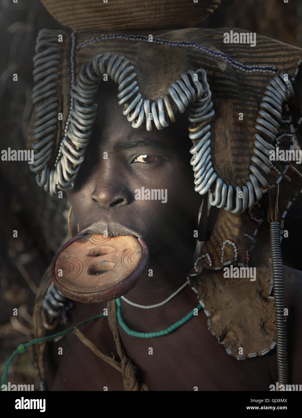 Woman of the Mursi Tribe with disc in her lower lip, Omo Valley, Ethiopia - Stock Image