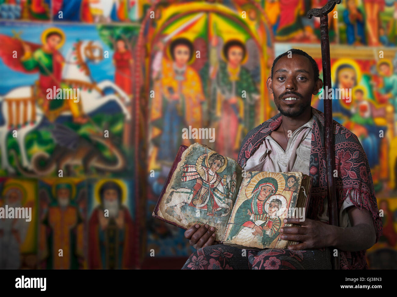 Priest showing an ancient religious book in an Orthodox Monastery