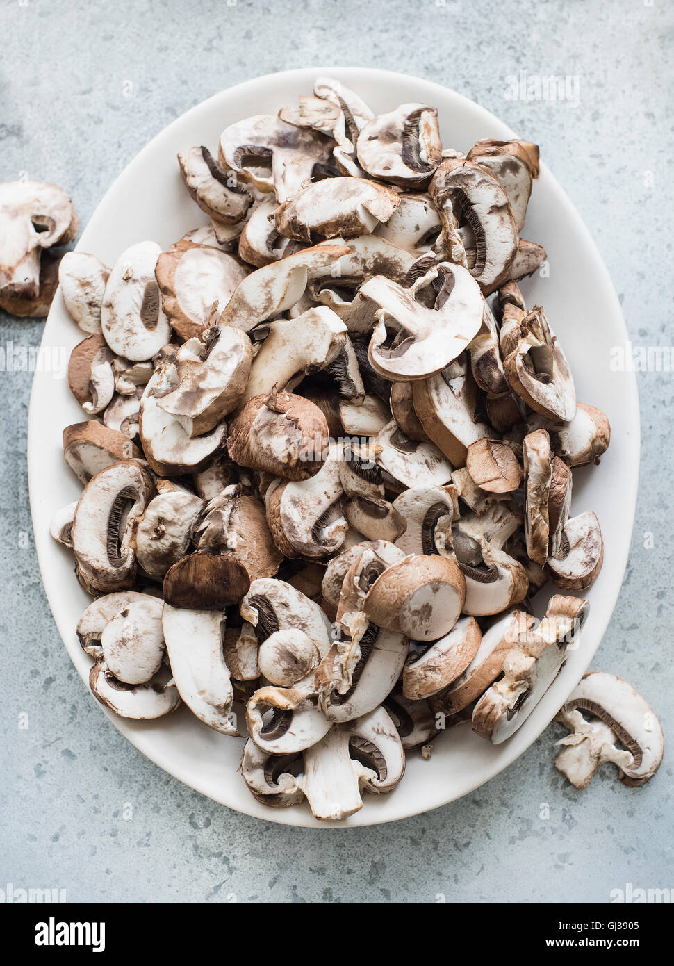 Overhead view of fresh sliced mushrooms on a plate Stock Photo