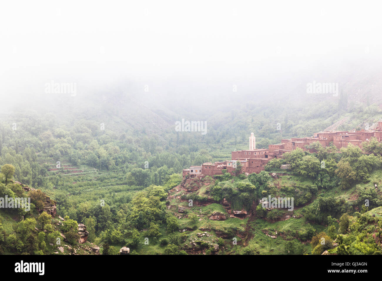 Misty landscape view of hillside village,  Ourika Valley, Marrakech, Morocco - Stock Image