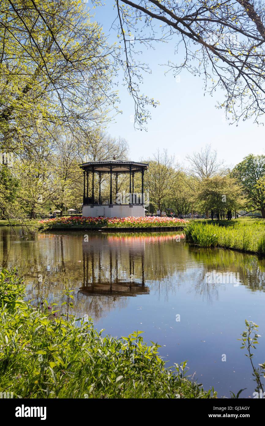 Bandstand and lake in Vondel Park in spring, Amsterdam, Netherlands - Stock Image