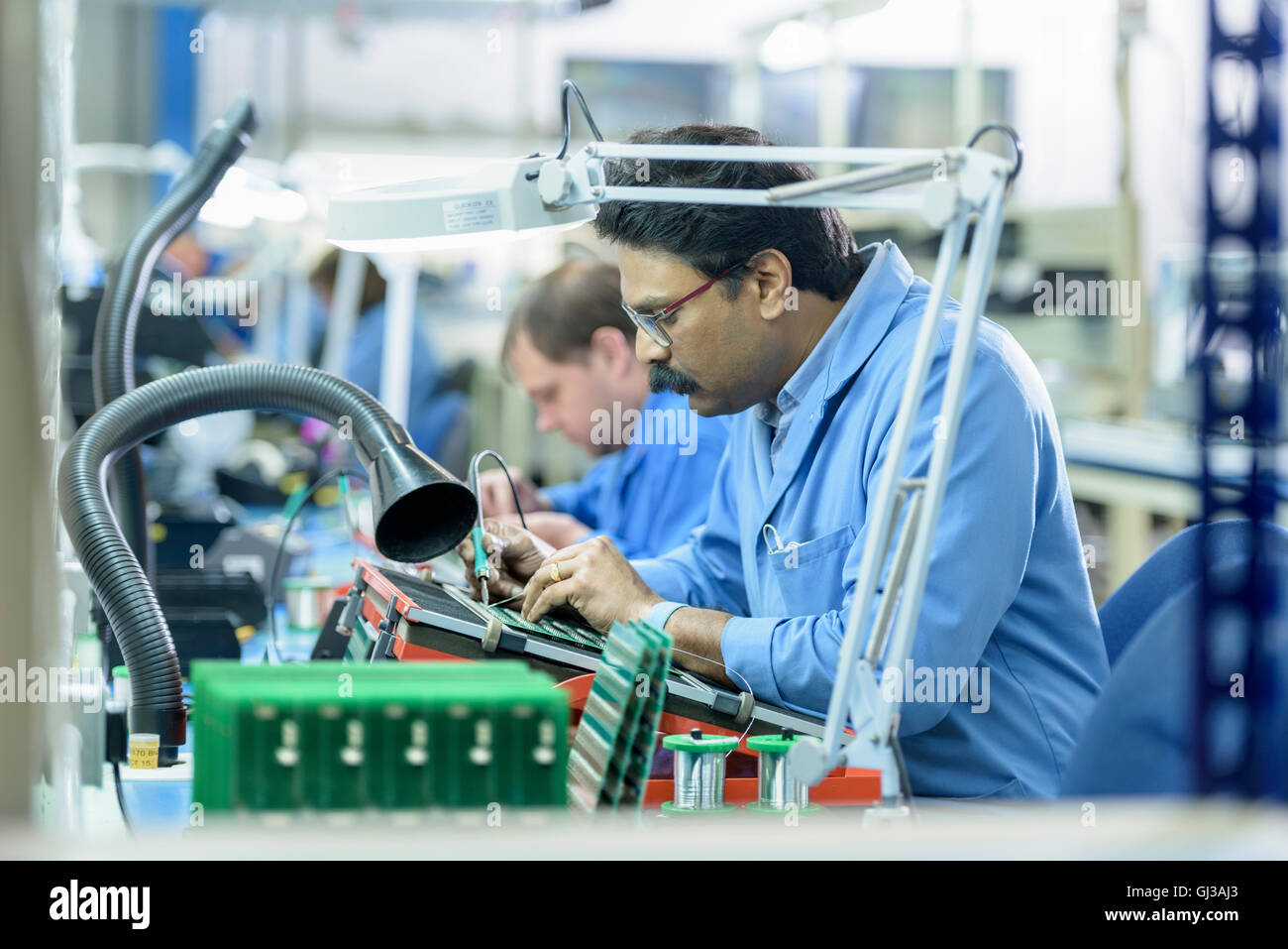 Soldering Circuit Board Stock Photos Electronic Assembly Jobs Worker Component Onto Boards In Factory Image