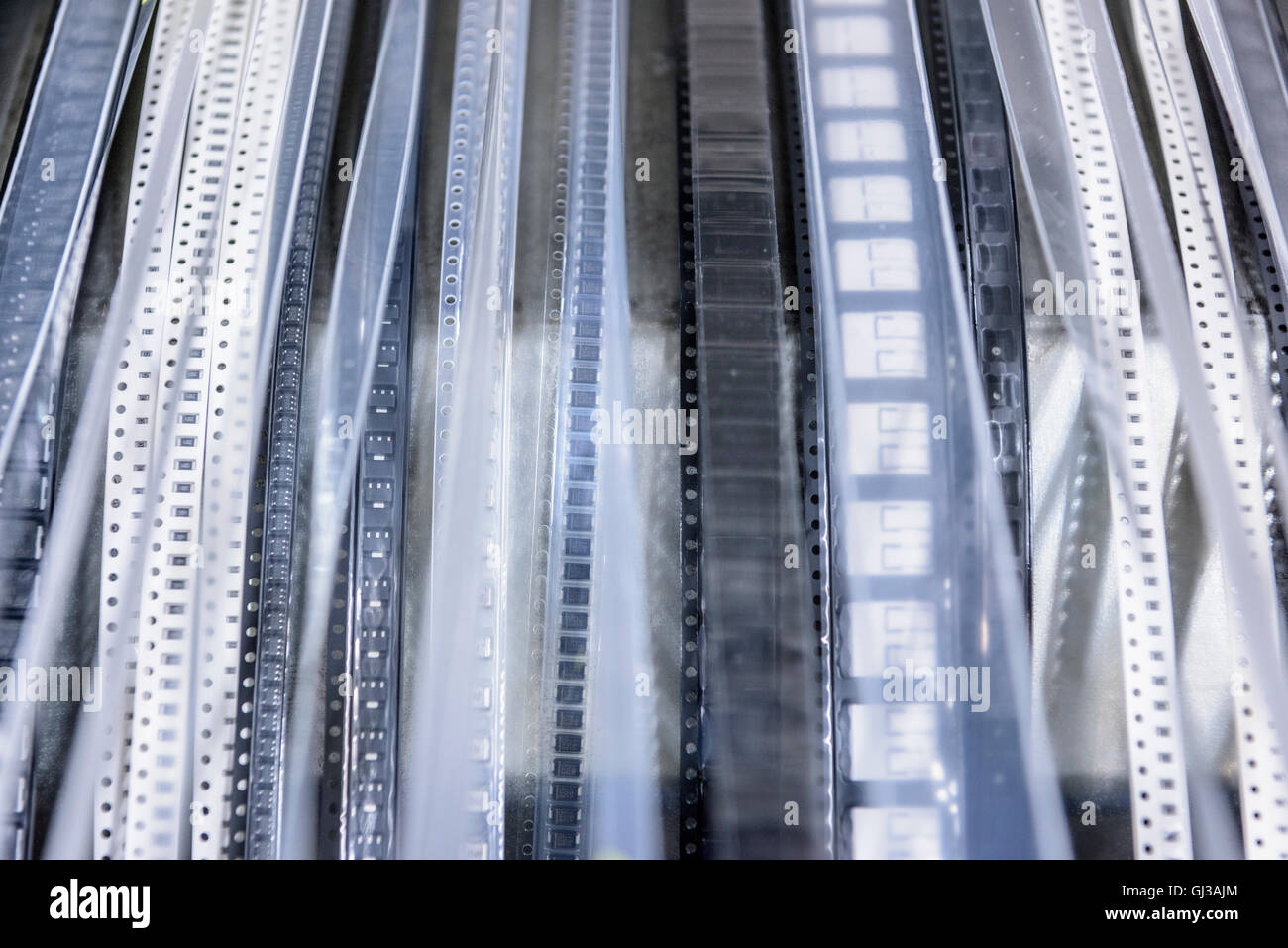 Ribbons of components in circuit board assembly factory Stock Photo