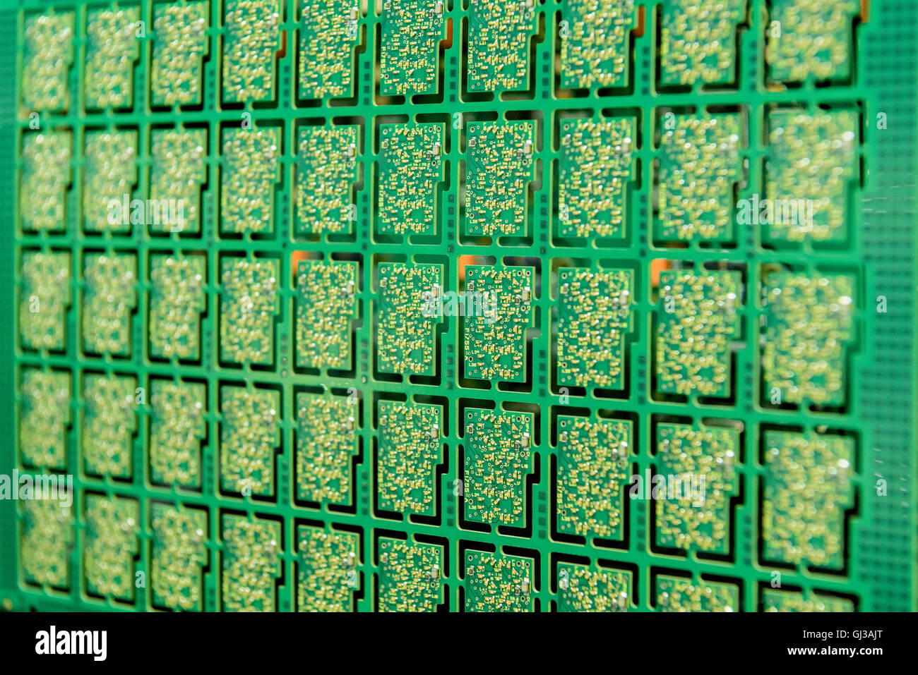 Detail of circuit boards in circuit board assembly factory, close up - Stock Image