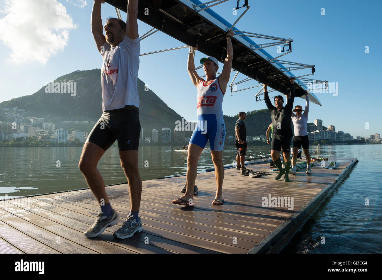 RIO DE JANEIRO - APRIL 1, 2016: Members of the Vasco da Gama rowing club carry their boat back to the clubhouse - Stock Image