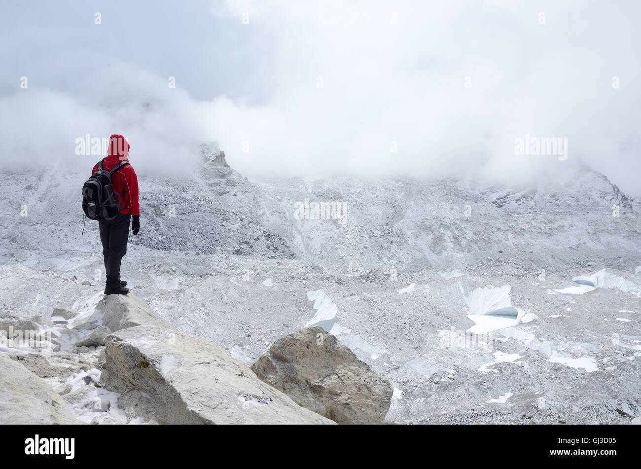 Mountaineer standing near Khumbu Icefall - one of the most dangerous stages of the South Col route to Everest's - Stock Image