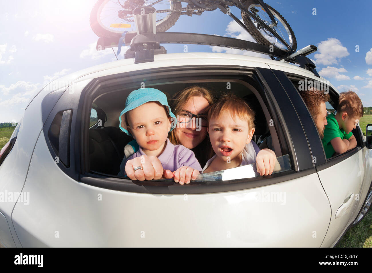 Big happy family going on vacation trip in summer - Stock Image