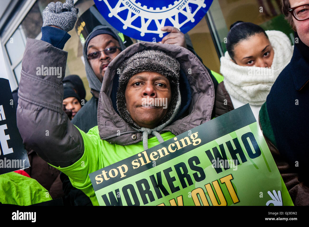 Chicago, Illinois - November 28, 2014: Striking Walmart workers and supporters protest outside a store on Black - Stock Image