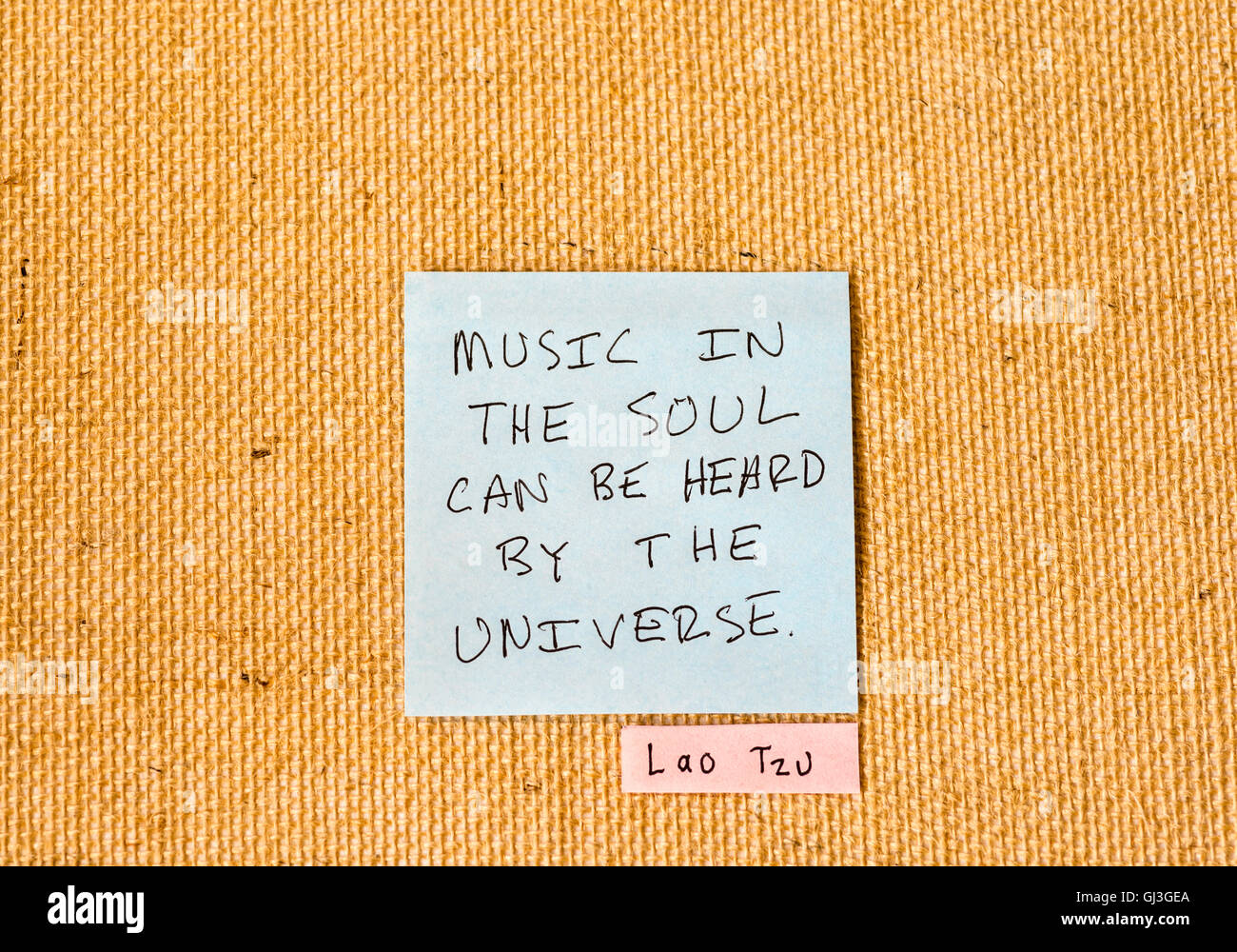Lao Tzu quote written on sticky notes on a burlap background. - Stock Image