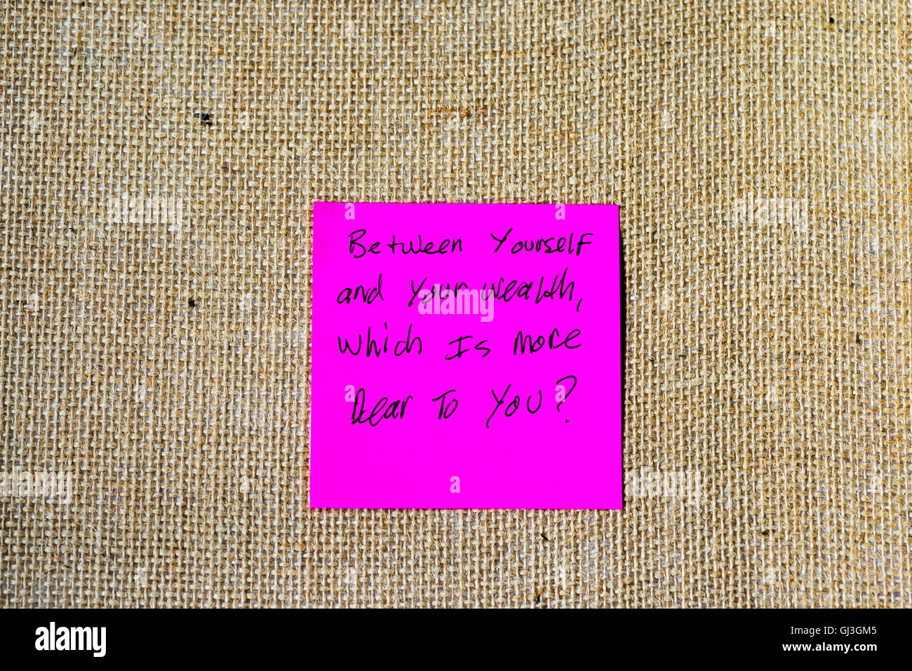 famous quote from the Tao Te Ching written on sticky notes, burlap background. - Stock Image