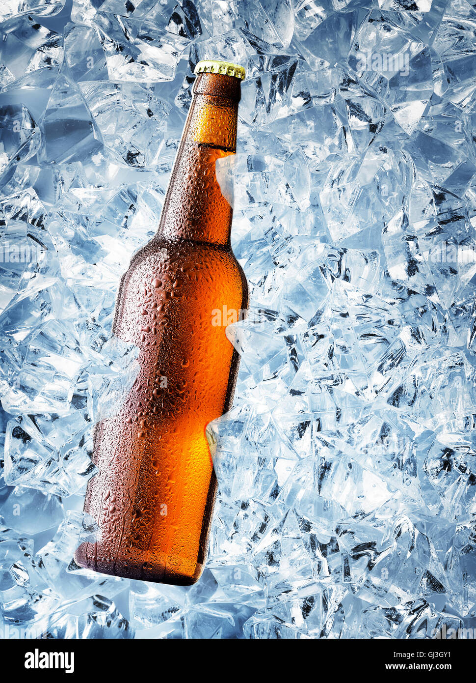 Brown bottle of beer with drops on ice cubes Stock Photo