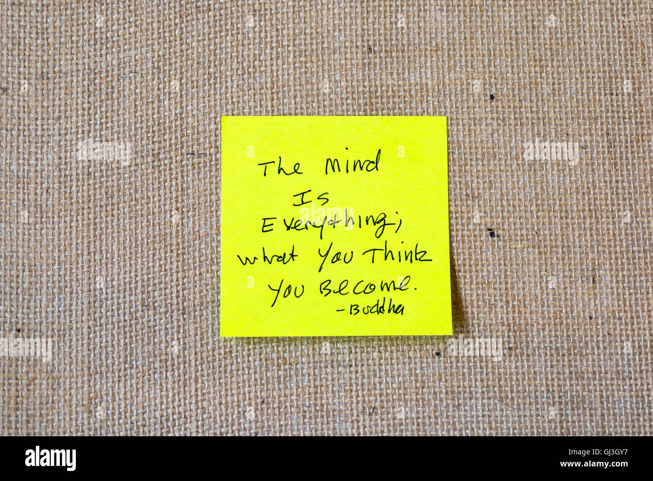 quote by Buddha written on sticky notes on a burlap background. - Stock Image
