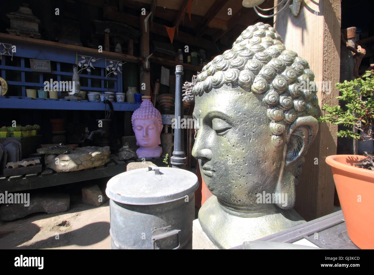Buddha garden statuary for sale inside Swifties reclamation yard in the antiques quarter of the City of Sheffield, - Stock Image