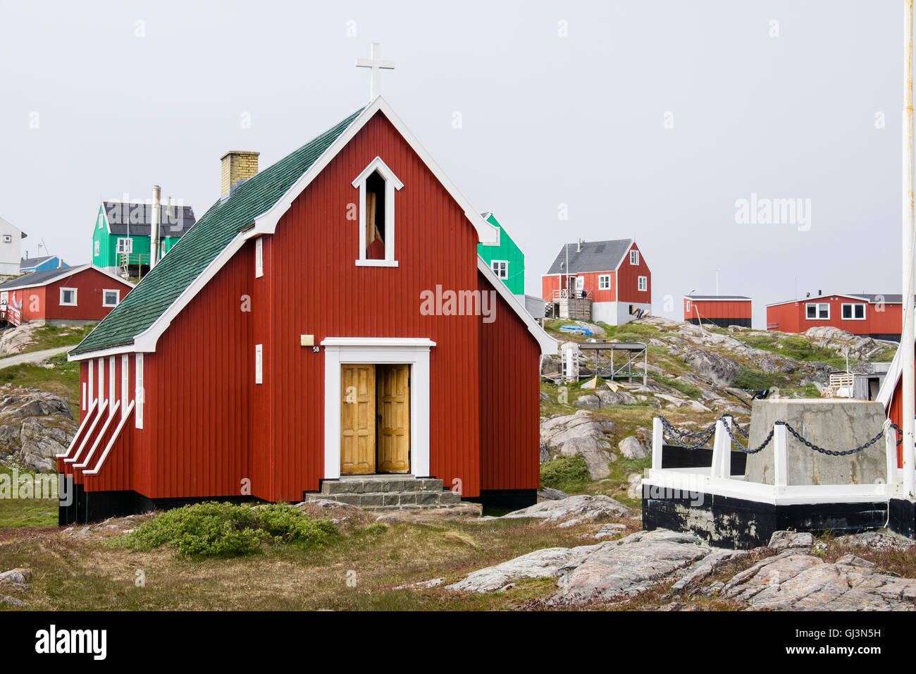 Traditional colourful wooden houses and small Inuit church. Itilleq, Qeqqata, Greenland. - Stock Image