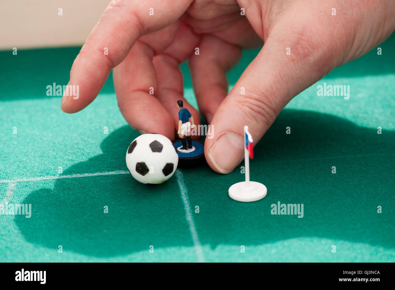 Person Playing Subbuteo Table Football - Stock Image