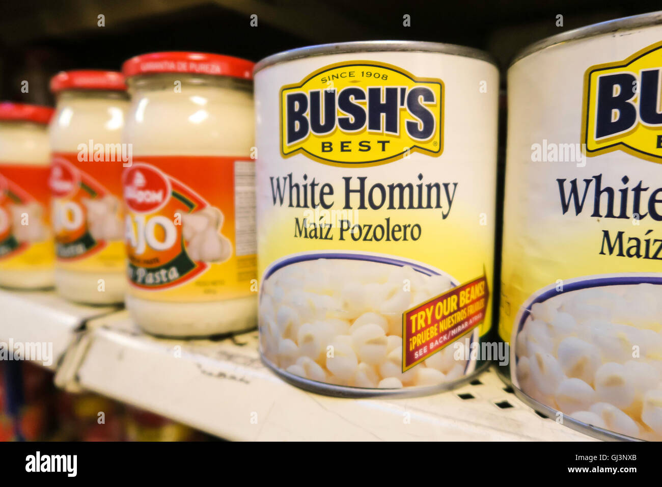 Cans of Bush's Brand White Hominy, Essex Street Market, NYC - Stock Image