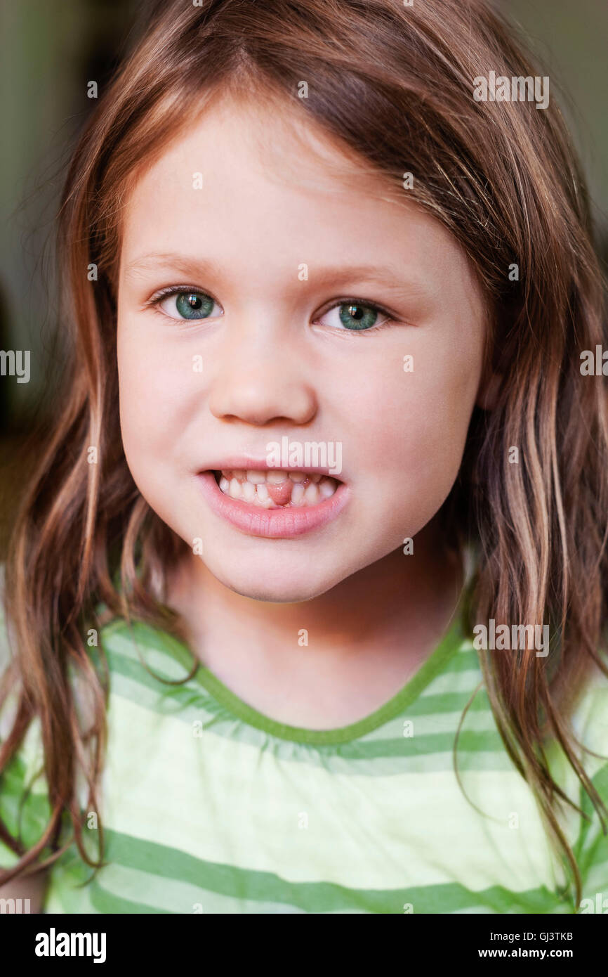 4-year-old girl, tooth gap, half portrait, - Stock Image