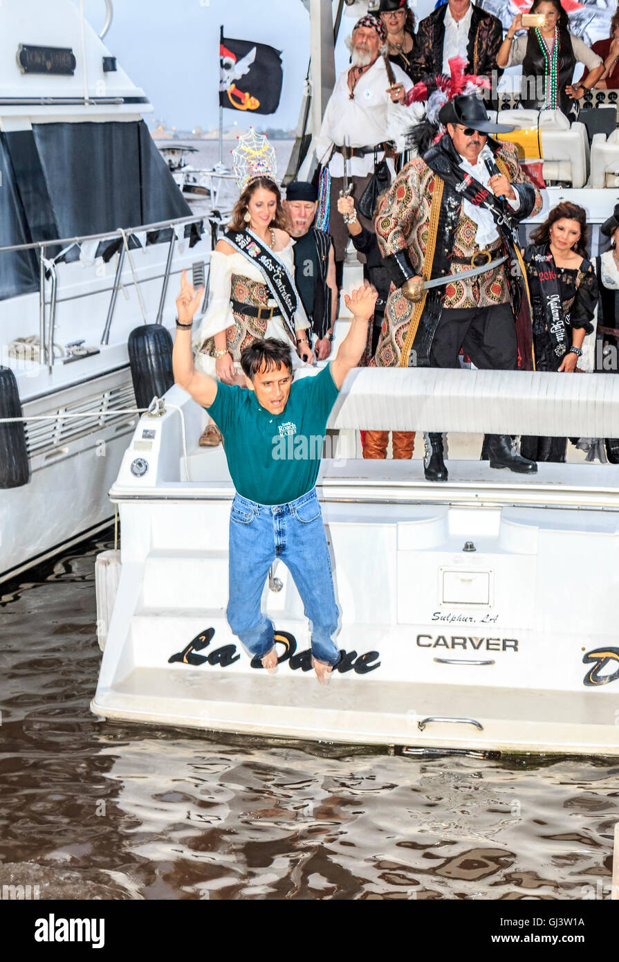 The Mayor of Lake Charles, Louisiana, 'walking the plank' during Contraband Days in Lake Charles, LA. - Stock Image