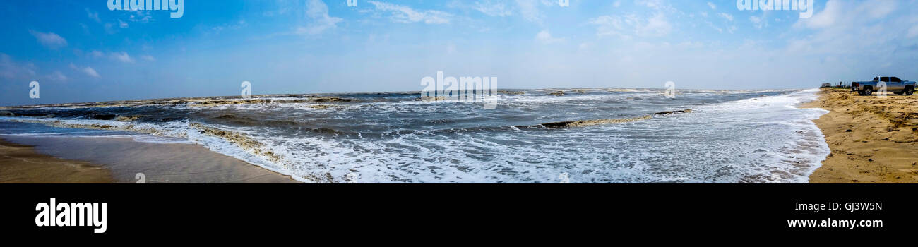 Panorama view of rough surf during a windy day at Rutherford Beach on the Gulf of Mexico coast in Louisiana. - Stock Image