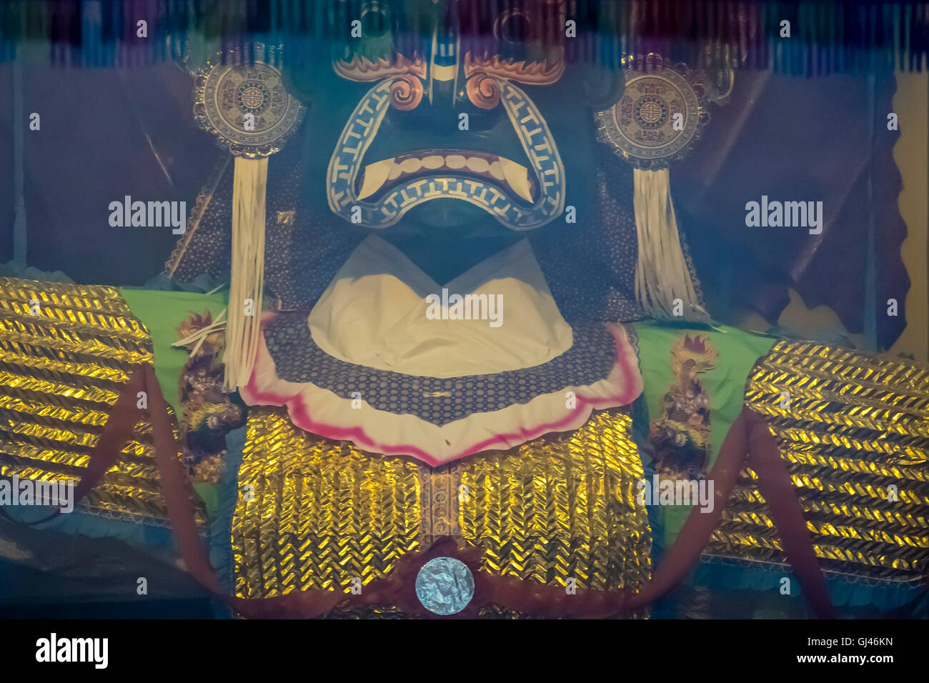 Kuala Lumpur, Malaysia. 12th August 2016. Day 2: From the thick joss smoke, King Hades looks out at the dinner guests. - Stock Image
