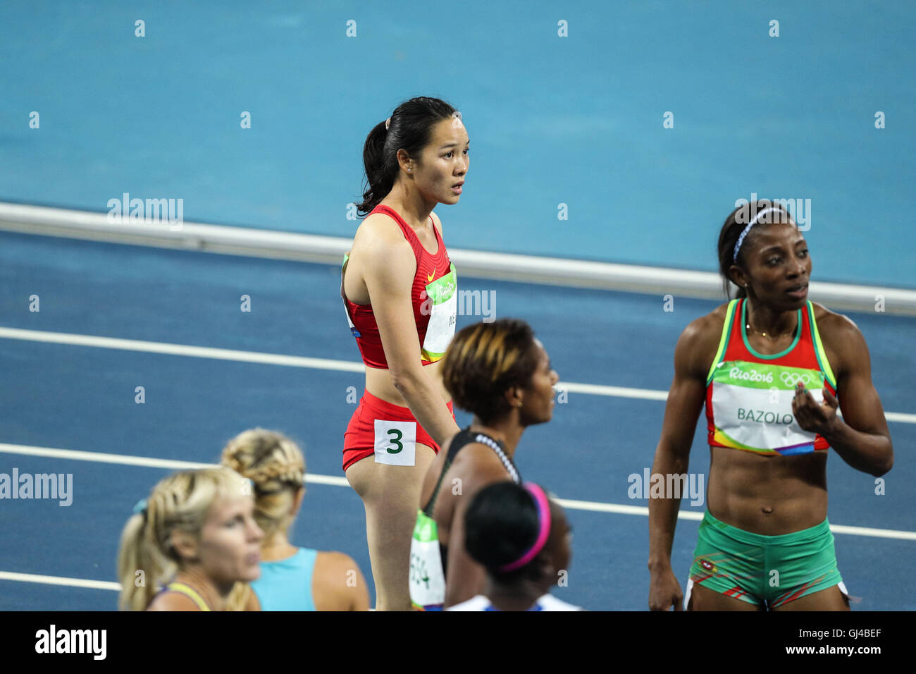 Rio De Janeiro, Brazil. 12th Aug, 2016. Wei Yongli of China (3th L) reacts after the women's 100m heat at the - Stock Image