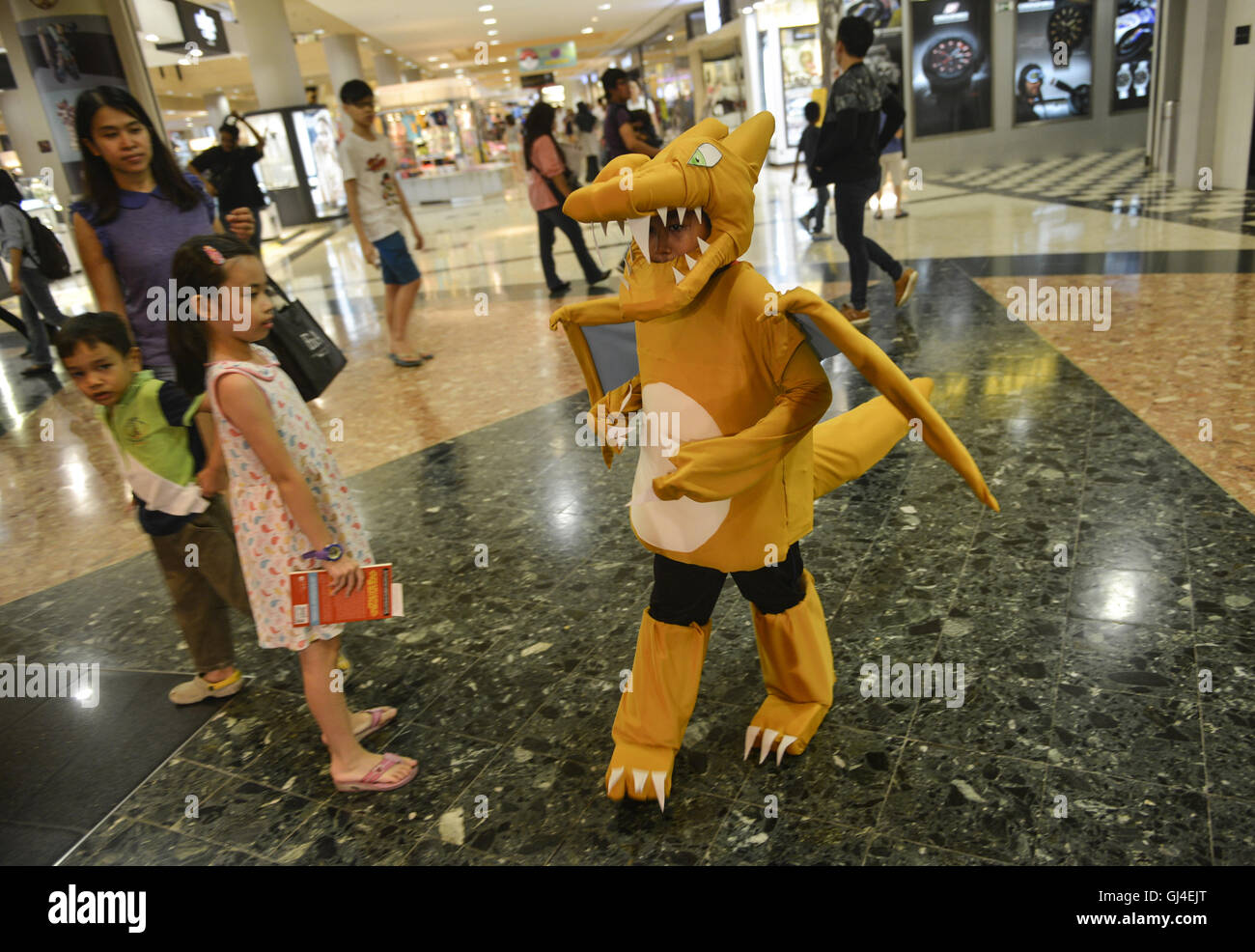 A boy wear Charizard costume fromu0027u0027 Pokemon Gou0027u0027 game during Pokemon Costume Contest at Sunway Pyramid Shopping Mall outside Kuala Lumpur.  sc 1 st  Alamy & Sunway Selangor Malaysia. 13th Aug 2016. A boy wear Charizard ...