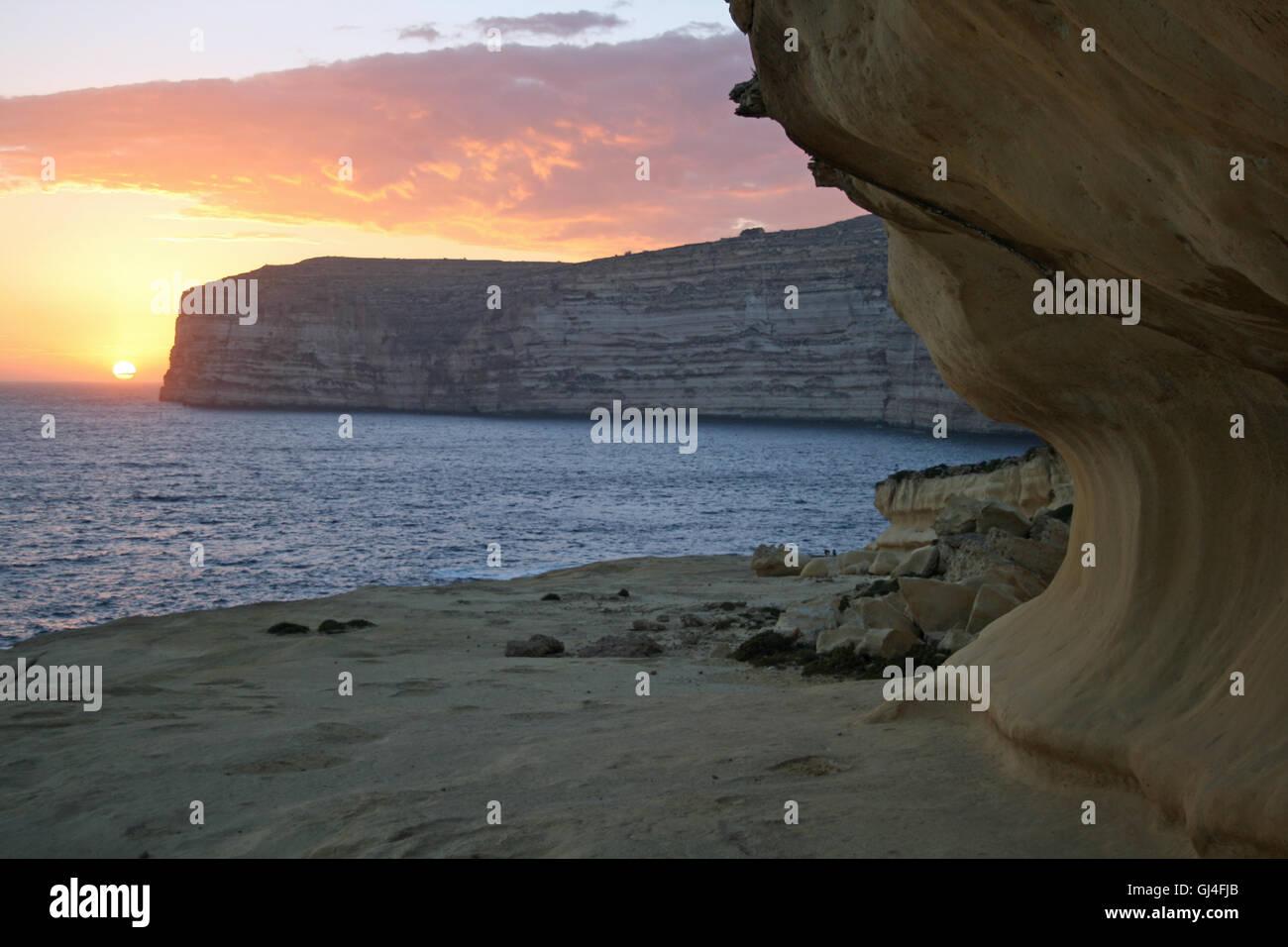 Xlendi bay at sunset - Stock Image