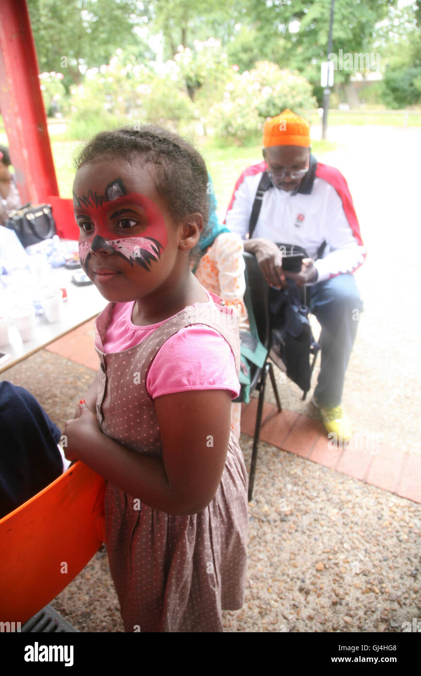 Community Impact Haringey, Chestnut Community Centre, Child facepainted by volunteers at Bridge Renewal Trust. - Stock Image
