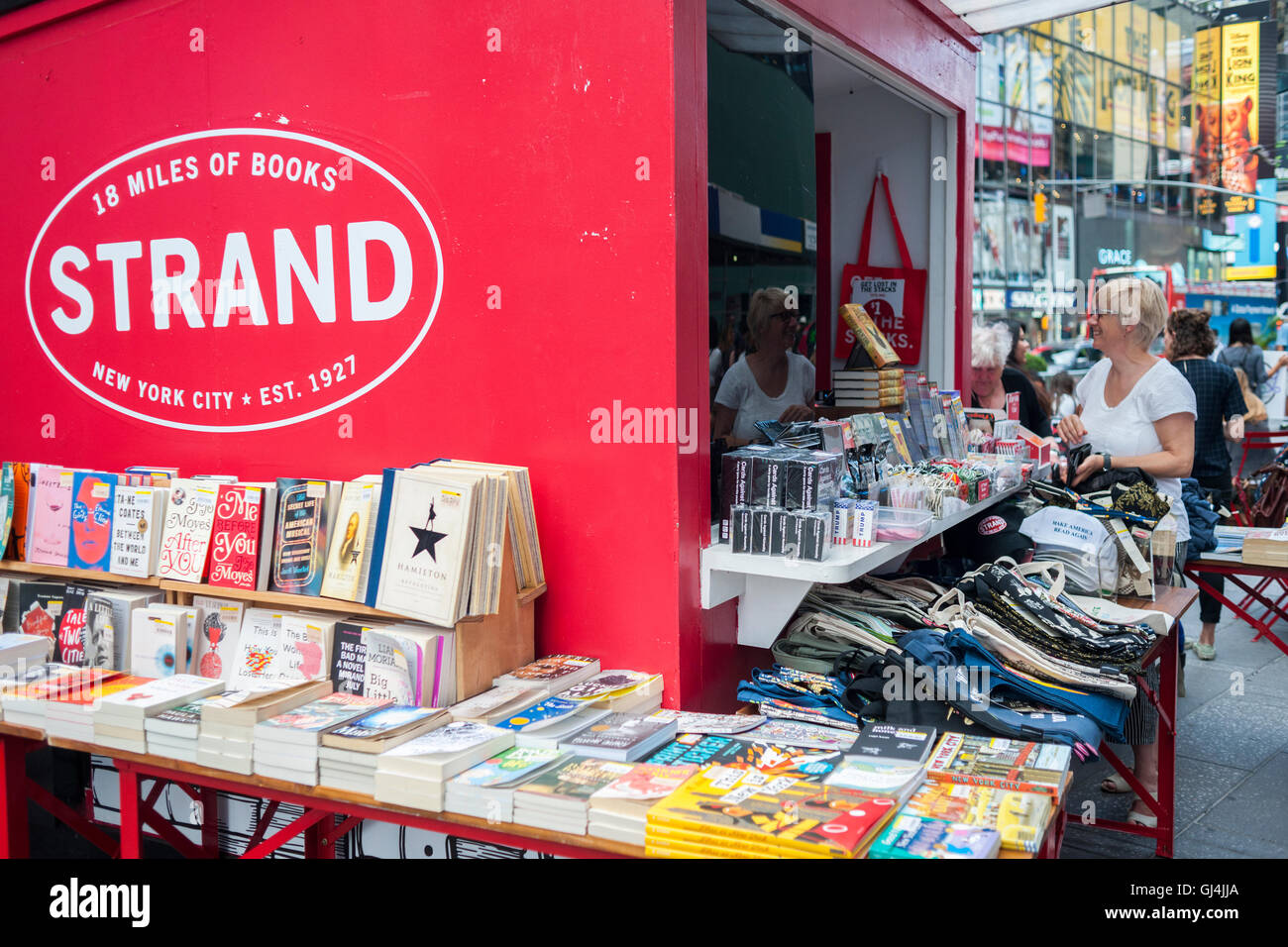 Customers browse books and novelties at a satellite of the famous Strand bookstore in Times Square in New York on - Stock Image