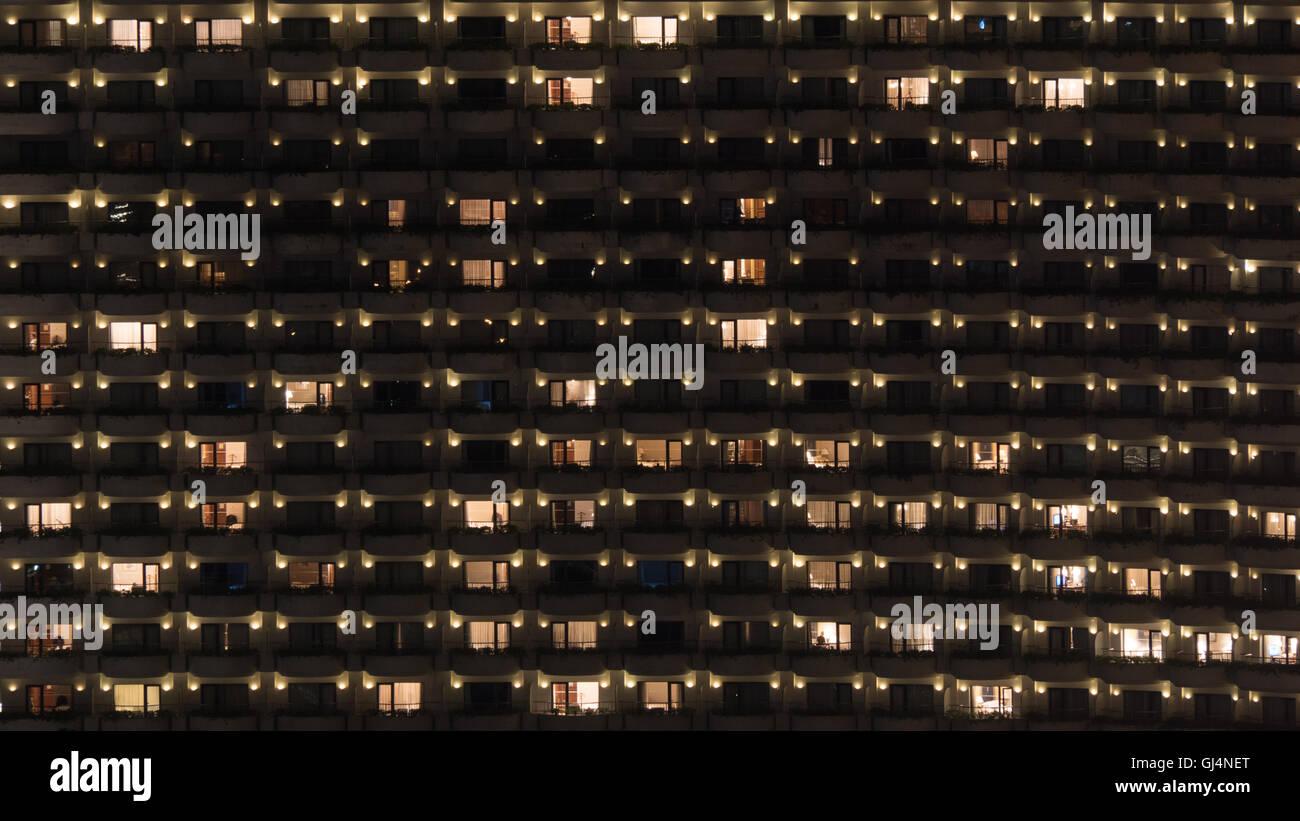 Multistorey block of flats at night - Stock Image
