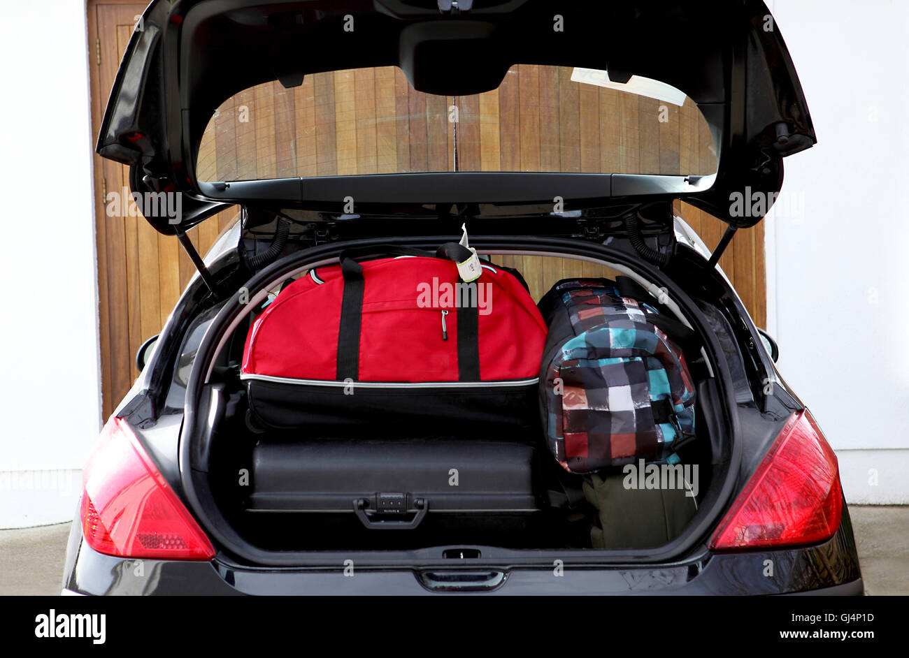 Suitcases and bags in trunk of car ready for vacation - Stock Image