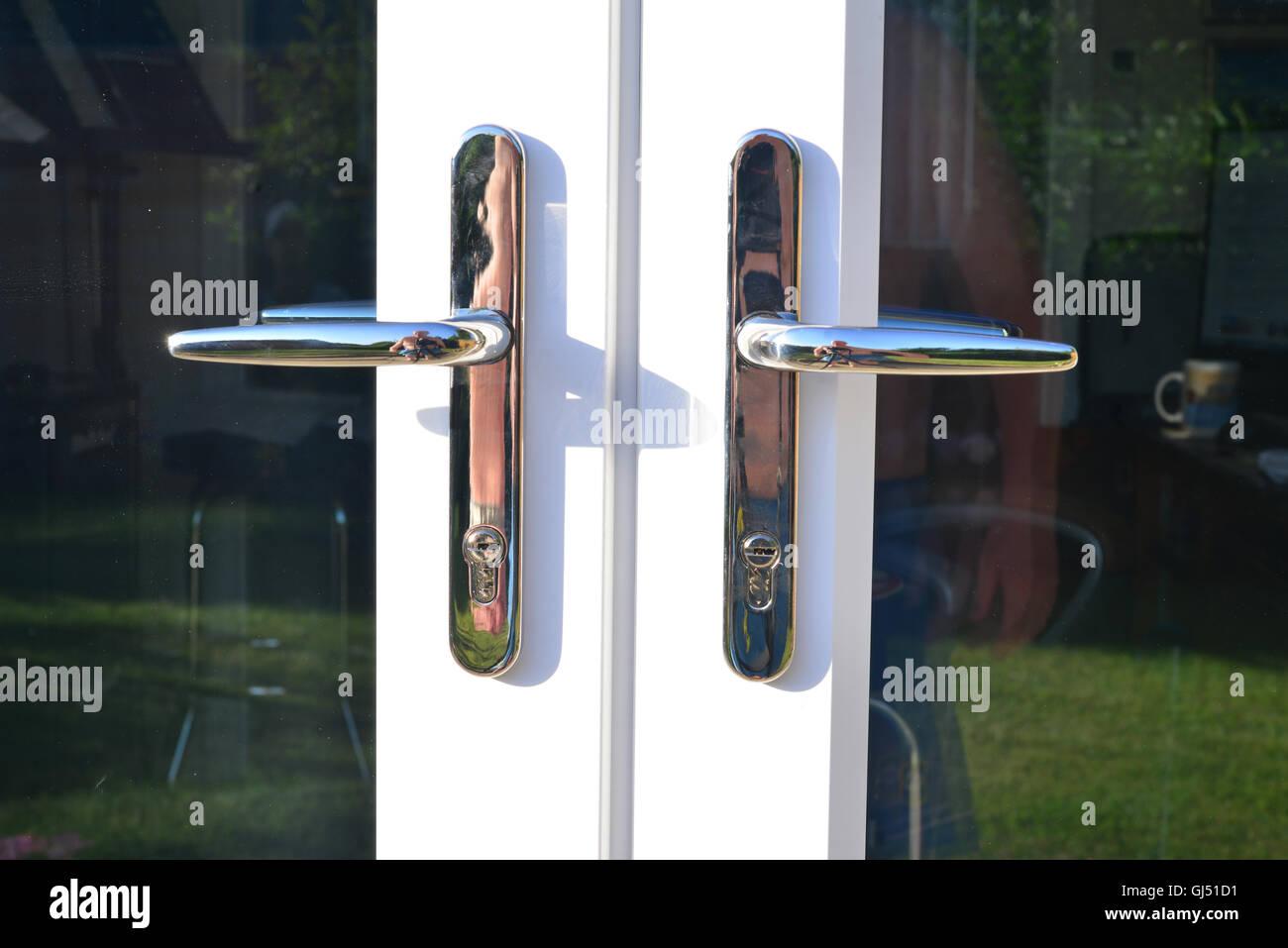 French door handles on French doors, - Stock Image