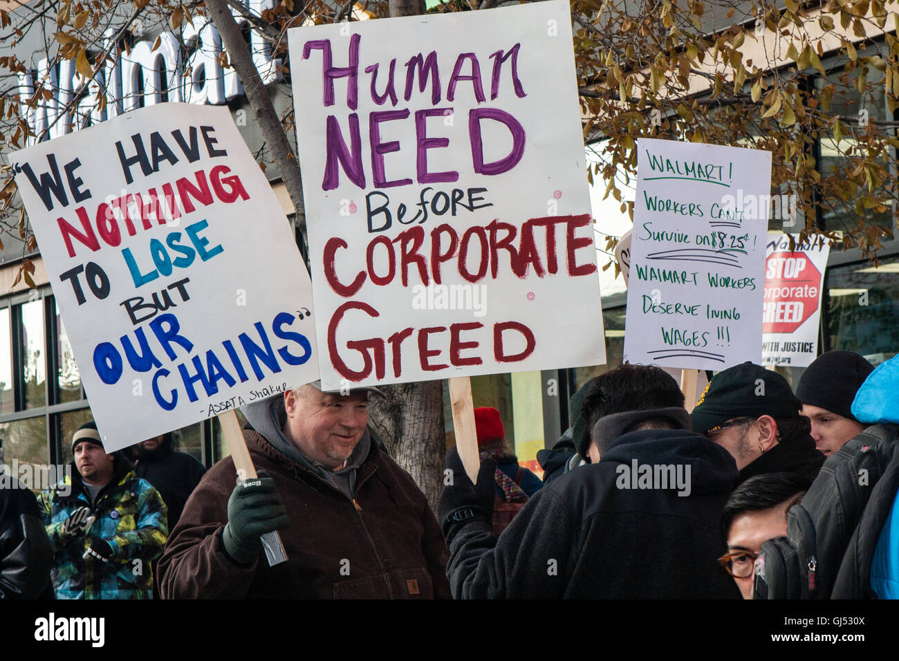 Chicago, Illinois - Nov. 29, 2013: Striking Walmart workers and supporters protest outside a Walmart Market store - Stock Image