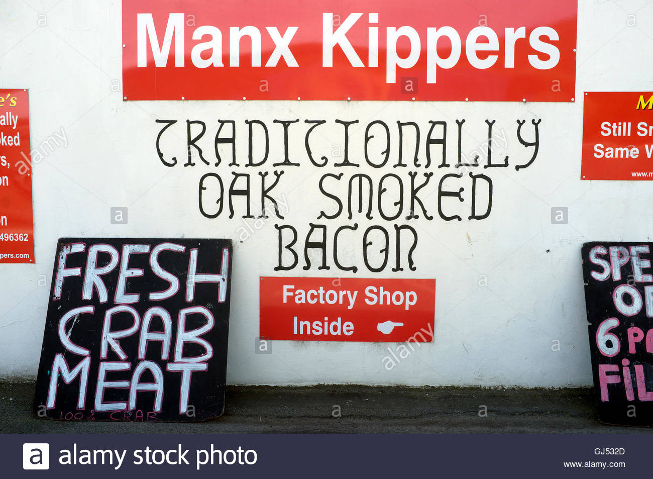 Manx Kippers, and other traditional foods, at a factory shop in Peel, Isle of Man, British Isles. - Stock Image