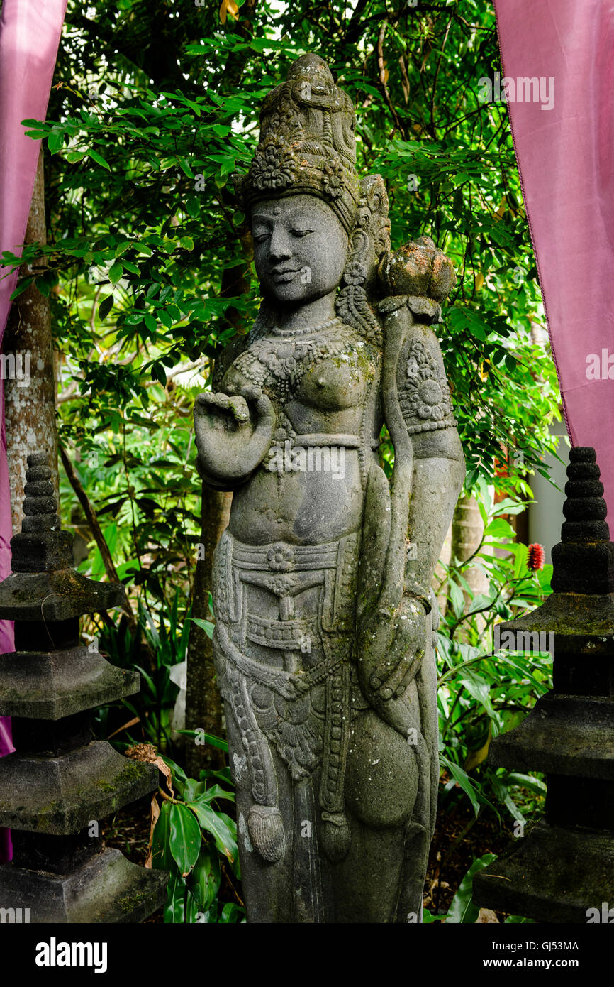 The Dewi Sri statue at Crystal Castle And Shambhala Gardens, close to Byron Bay. - Stock Image